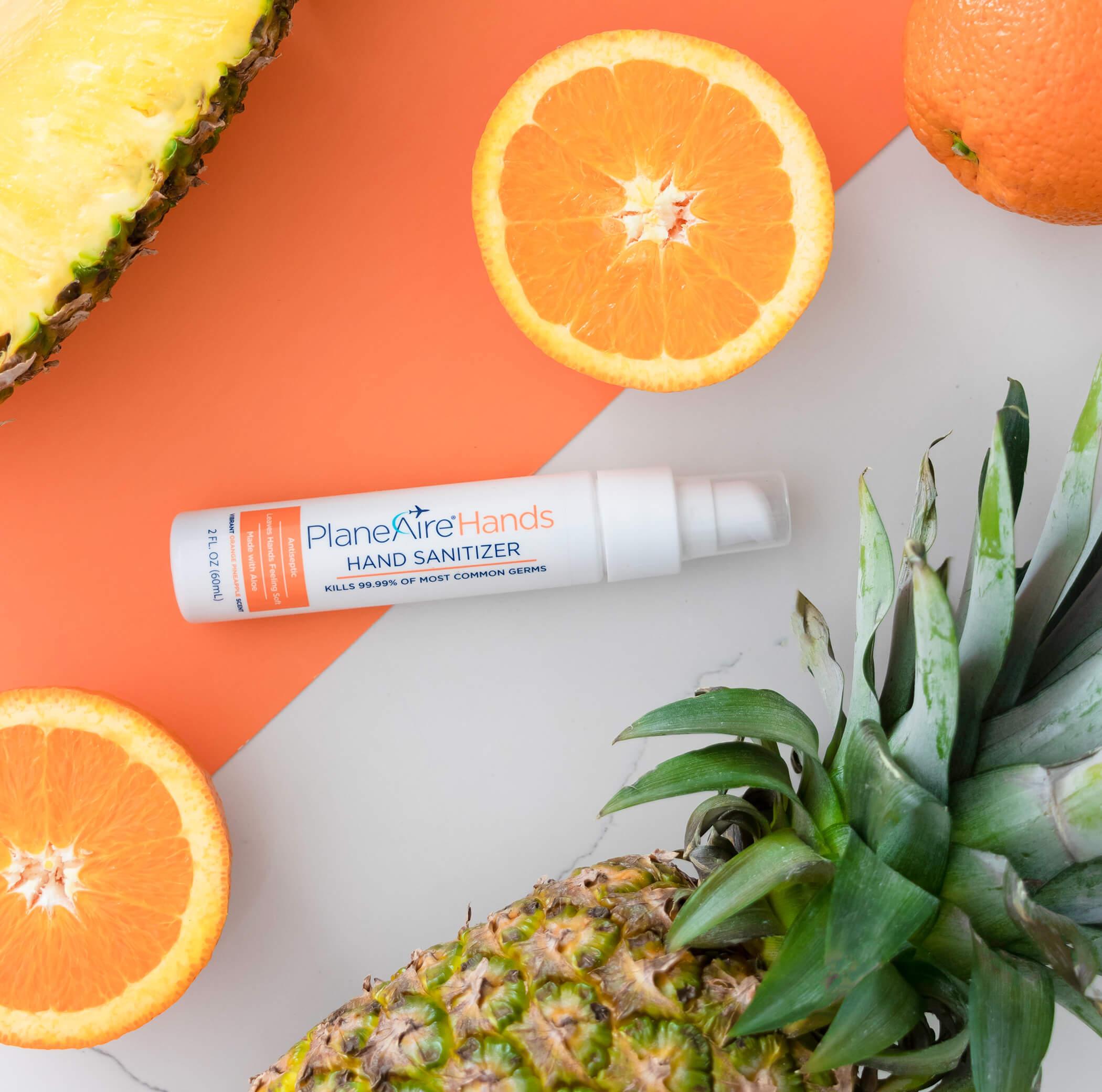 PlaneAire Hands Orange Pineapple